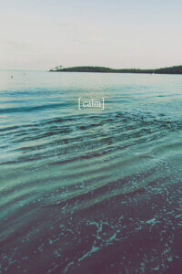 """""""Grow Calm I"""" by Urban Epiphany shows the word """"calm"""" written in white with an ocean in the background."""