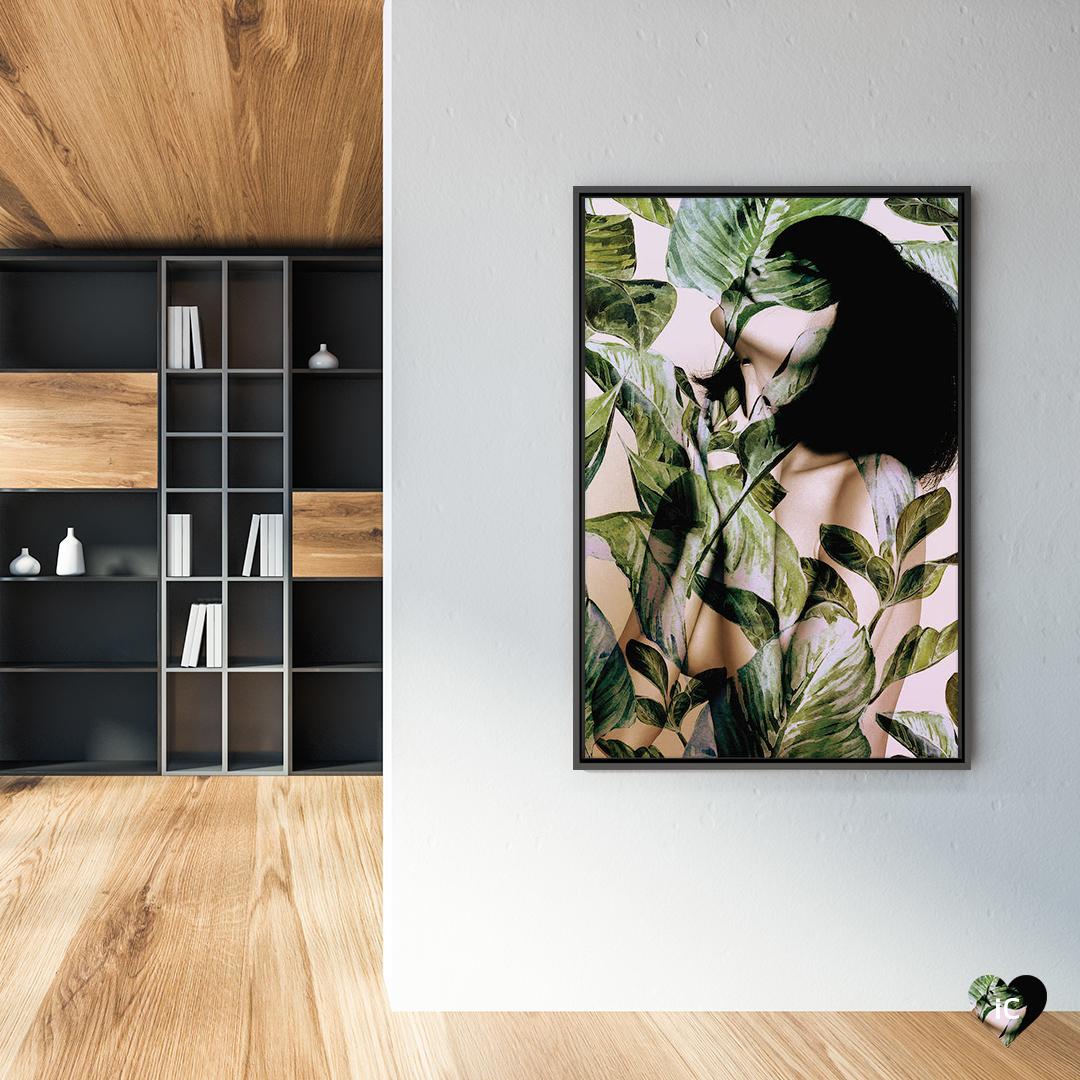 """In Bloom I"" by Andreas Lie shows a woman with black hair tangled in green leaves."