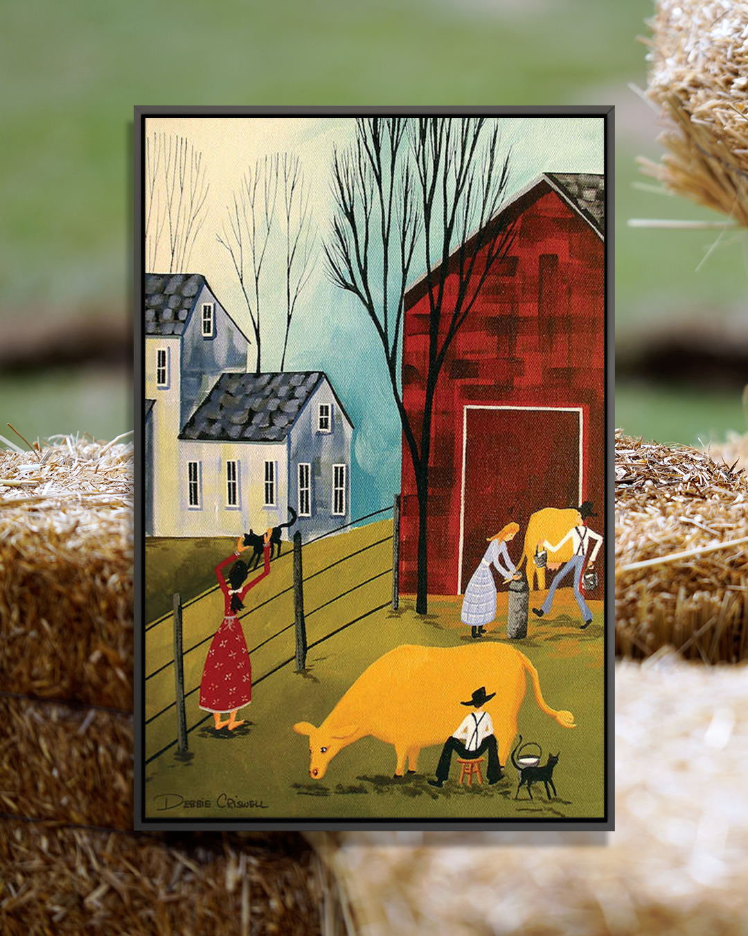 """""""Milking The Cows"""" by Debbie Criswell shows people milking two cows while a woman pets a black cat on the fence in the background."""