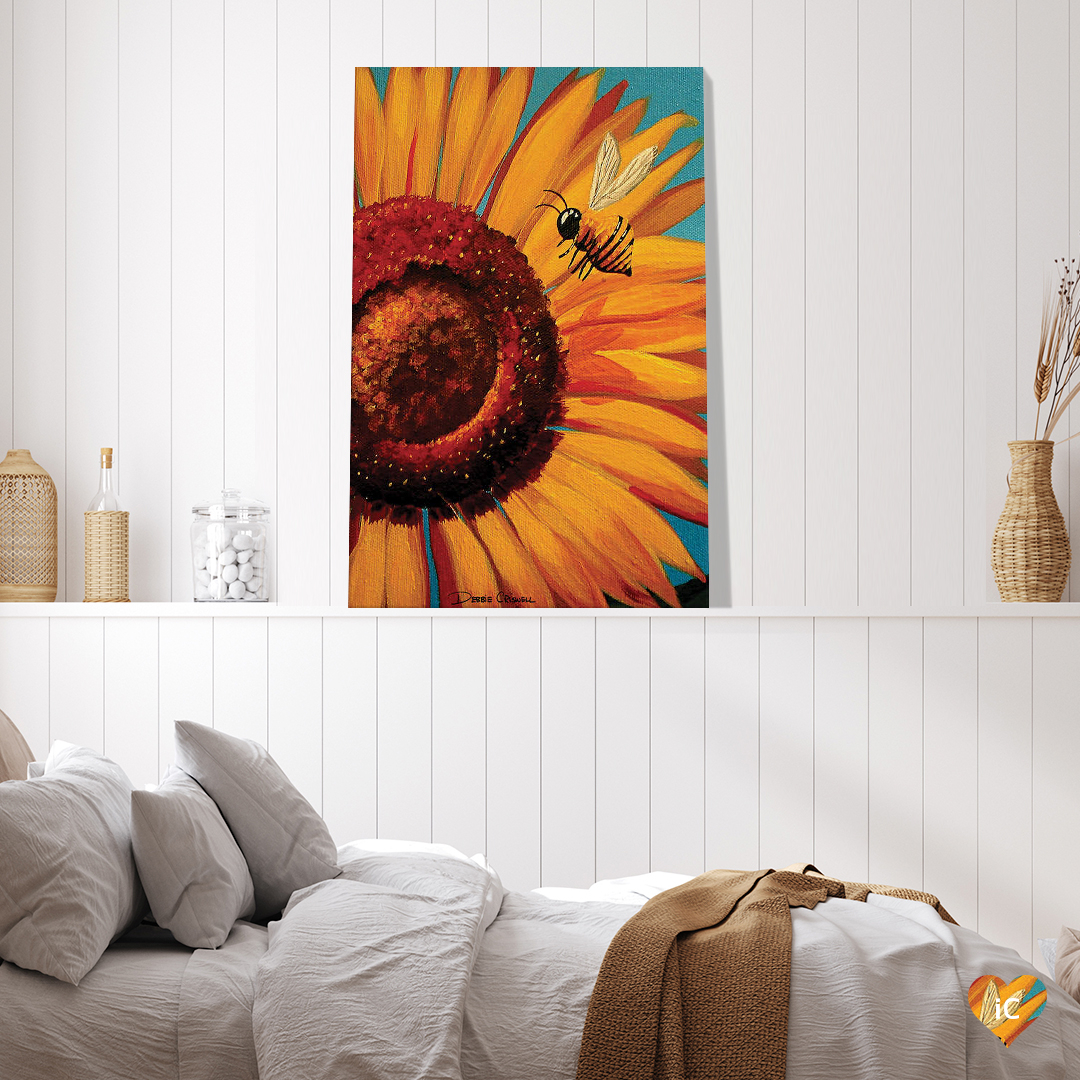 """""""Sunflower Bee"""" by Debbie Criswell shows a bee flying in front of a yellow sunflower."""
