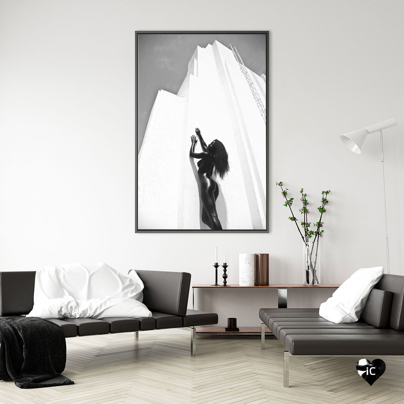 """""""Climbing"""" by Gregory Prescott shows a black and white photo of a black woman with long hair leaning against a tall white skyscraper"""
