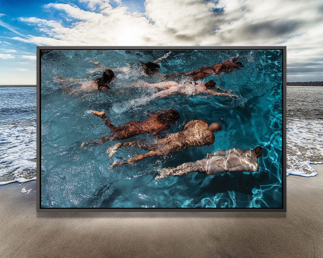 """""""Swim Meet"""" by Gregory Prescott shows a photo of seven people of various genders and races swimming in blue water"""