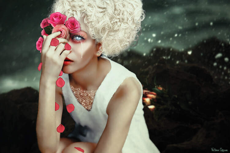 """""""Forlorn"""" by Victoria Obscure shows a woman with bleached hair holding pink roses over her glowing blue eyes."""