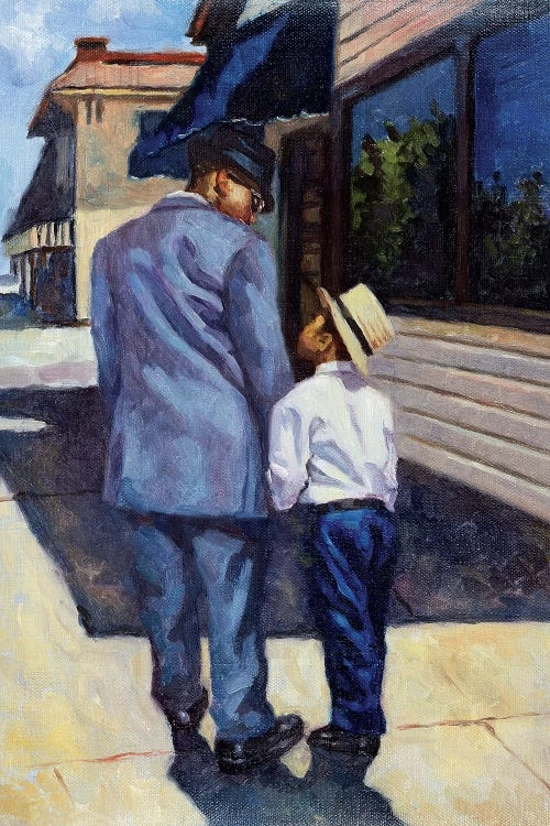 A black man wearing a blue suit and hat holding a young black boy's hands outside on a street