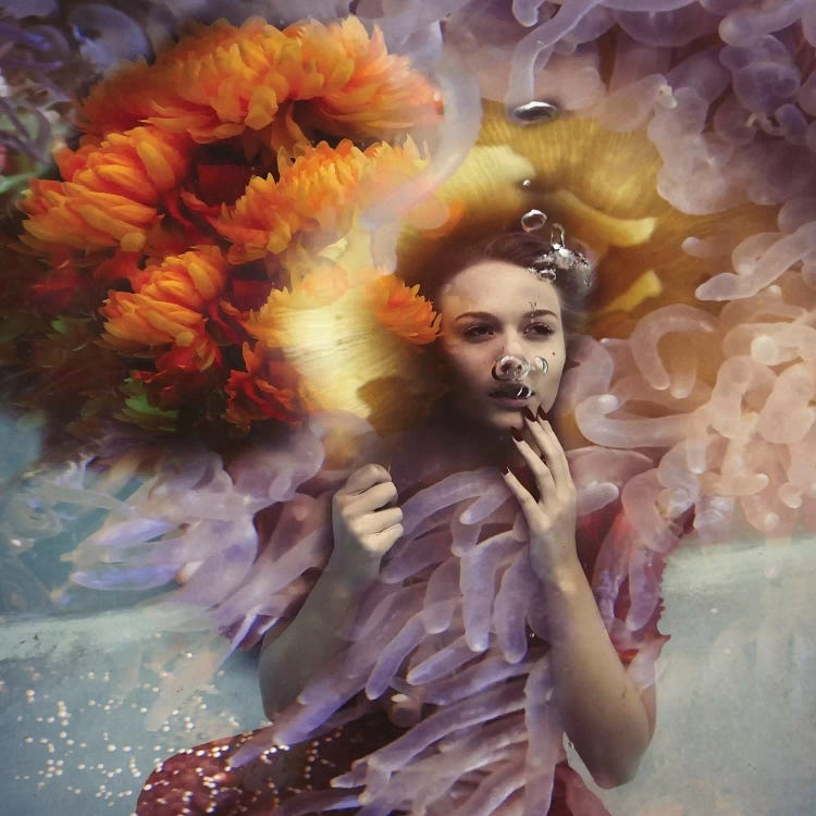 Gracie by Lola Mitchell showcases a woman underwater with bubbles coming from her mouth surrounded by floral-like waves