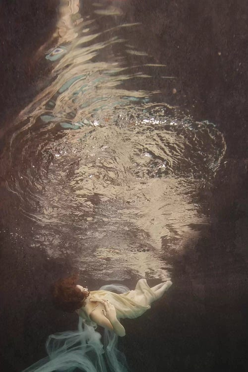 Reflections II by Lola Mitchell showcases a woman underwater while wrapped in a gray-white fabric