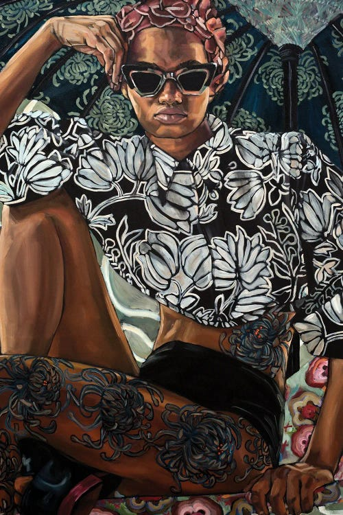 portrait of a black woman with tattoos on her legs and side with a floral top on by iCanvas artist Belinda Eaton