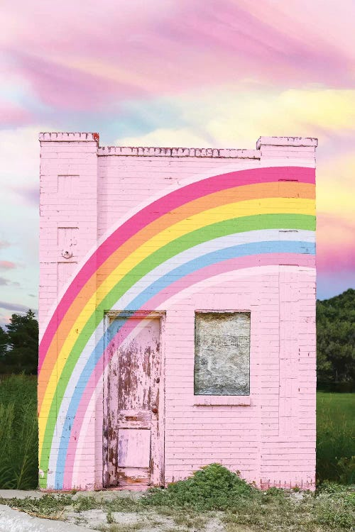Wall art of a pink building with a rainbow across it by iCanvas artist Erin Summers