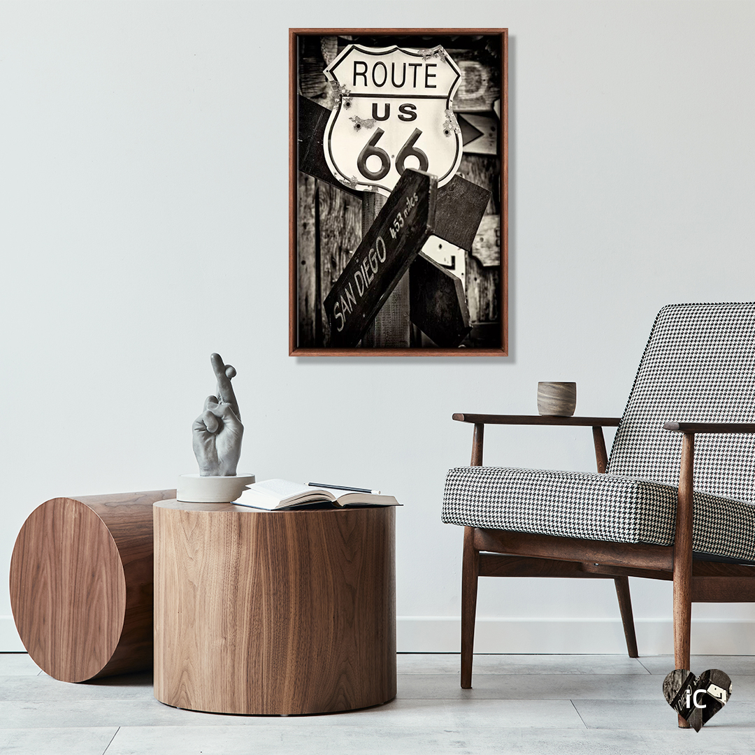 Wall art of Route 66 photograph by Philippe Hugonnard above a wooden table and chair by