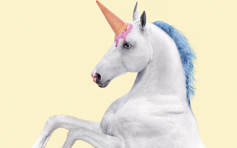 Wall art of a white unicorn with ice cream cone on head