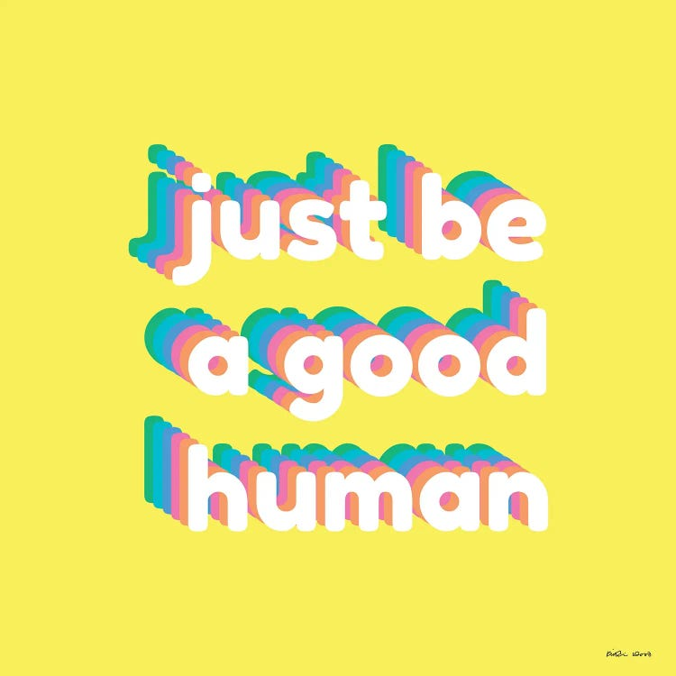 Yellow wall art with just be a good human written in rainbow colors by female artist Kristin Wood