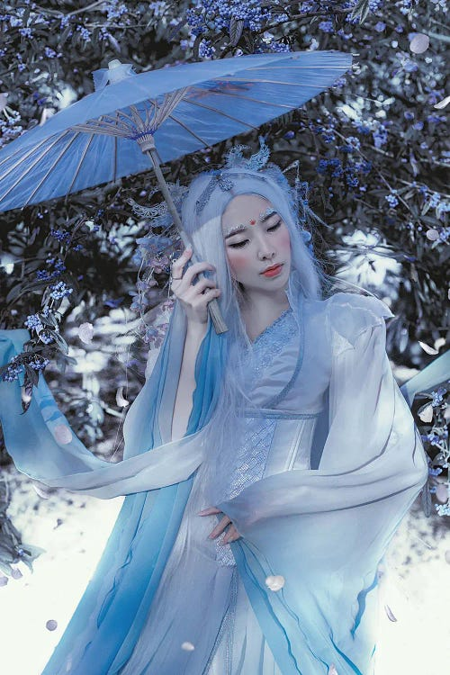 Photography of an Asian woman in blue with a blue parasol by iCanvas artist Lillian Liu