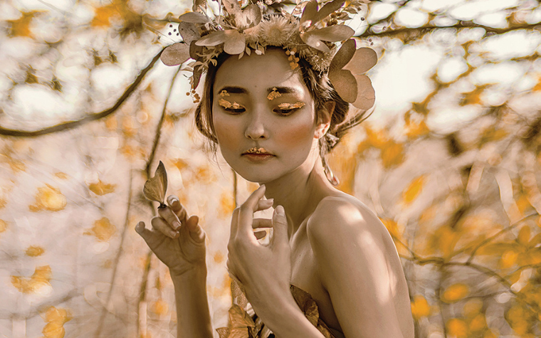 Photography of an Asian woman surrounded by orange butterflies and flowers by iCanvas artist Lillian Liu