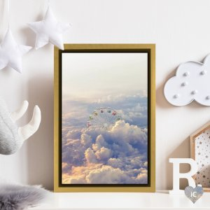 Framed wall art of a Ferris wheel above the clouds by iCanvas artist en.ps