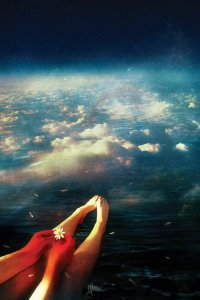 2021 art trend art of a persons legs and hands holding a daisy floating above the clouds