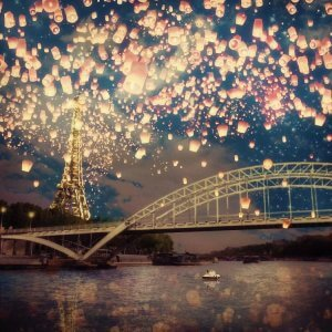 Wall art of the Seine and Eiffel Tower with paper lanterns in the sky
