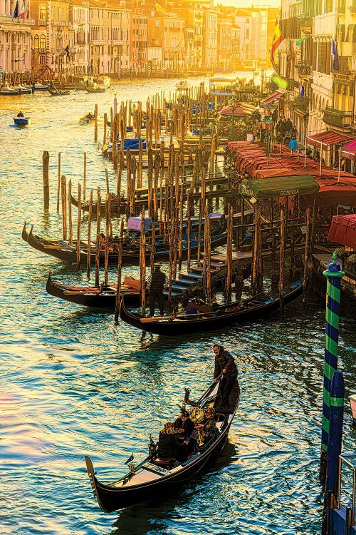 Photography of gondolas docked in canal by new creator chris lord